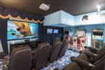 The theater and games room is perfect for nights on while on vacation