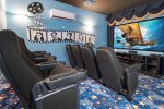 There are theater style seats for 8 and 100-inch projection screen