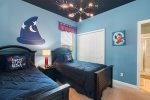 The kids will have their own room with two twin beds and custom art work in ceilings