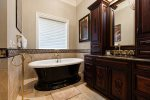 The second master bathroom has a gorgeous soaking tub and shower