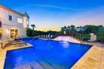 This expansive home has a large pool deck for your next luxury vacation