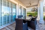 Dine al fresco in the beautiful Florida weather at the dining table for 6 on the back patio