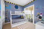 A fun kids bedroom with a twin over full bunk bed