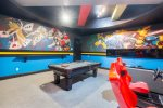 Check out the hand painted mural of the super heroes on the wall