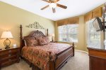 A master suite located on the first floor with a king size bed and en-suite bathroom