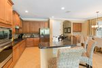 The gourmet kitchen is fully equipped and features stainless steel appliances