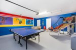 It features a foosball table, pin pong table, and a double shot arcade