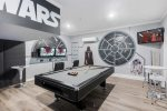 Play all day in this custom galaxy game room