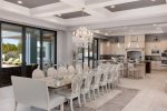 The dining table can seat up to 20 guests and 27 with bar stools