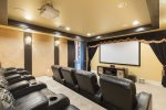 Watch movies with everyone in the stadium seating theater room.