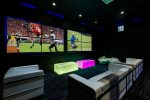 The Kids Club with two 110-inch 4K SMART video wall, PlayStation 4, Xbox 360, Apple TV, and ample seating