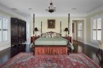 Master suite 1 with a Charleston theme has a king bed and en-suite bathroom
