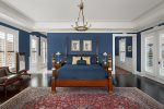 The master suite 2 features a New Orleans theme with a king size bed and en-suite bathroom