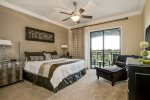 The third master suite features a king bed, 32-inch TV, and access to private patio balcony