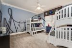 There is another kids bedroom feature two twin over full bunk beds and en-suite bathroom