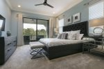Master suite located on the second floor features a king size bed and 50-inch SMART TV