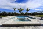 Soak up the Florida sun in your private pool with spillover spa