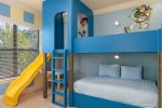 The room features two full beds and two twin beds for the little ones