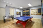 Spend your days in the custom games room