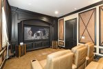 Host a movie night in the private theater room with a 96-inch projection screen and Apple TV