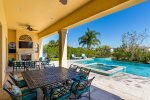 The covered lanai features luxury patio furniture