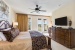 The master suite features a king size bed, 45-inch TV with DVD, Netflix, and access to balcony