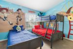 The kids bedroom features a twin single and a twin over full bunk bed