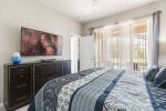The master suite has access to the pool area and 55-inch SMART TV