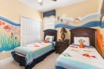 The fun kids bedroom features 2 twin beds