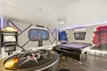 This fun game room features tons of custom artwork