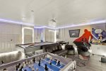 Play a game of foosball, air hockey or pool