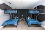 Featuring two twin/twin bunks for 4 kids total