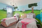This fun custom bedroom has two full beds