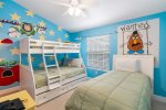 Head upstairs to the fun custom kids bedroom