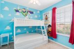 A bedroom perfect for the kids with a twin/full bunk bed