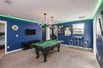 Another game room with a pool table