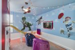 Shrink to the size of a toy in this fun themed bedroom