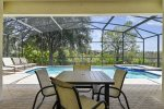 The patio is surrounded by a beautiful Florida nature conservation