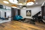 Take in the melodies of a beautiful grand piano in this salon