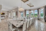 This luxurious formal dining table seats 20 guests to enjoy meals together