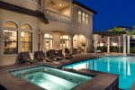 A custom built 60-foot private pool with spillover spa and sunken pool bar