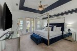 A luxurious master suite featuring a comfortable king sized bed