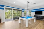 Play a round of pool upstairs in the lounge area loft