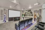 The whole family will love watching movies together in this custom theater