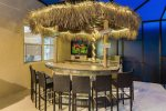 Lights at night make this tiki bar the place to be
