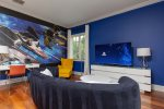 This bedroom also has a PlayStation 4 for the kids to enjoy