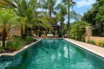 You`ll adore this beautiful pool surrounded by tropical flora