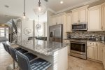 Enjoy the fully-equipped kitchen, complete with stainless steel appliances and granite countertops