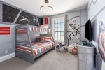 Kids will love this fun custom bedroom with a single over full bunk bed