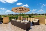 Sectional sofa with fire pit and umbrealla for shade